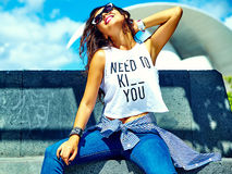 Stylish brunette model in hipster clothes outdoors Royalty Free Stock Photo