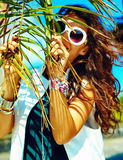 Stylish brunette model in hipster clothes outdoors Royalty Free Stock Image