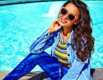 Stylish brunette model in hipster clothes outdoors Stock Image
