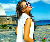 Stylish brunette model in hipster clothes outdoors Royalty Free Stock Photography
