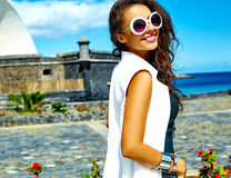 Stylish brunette model in hipster clothes outdoors Stock Photography