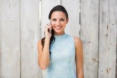 Stylish brunette on the phone Royalty Free Stock Photography