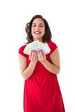 Stylish brunette in red dress holding cash Royalty Free Stock Images
