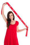 Stylish brunette in red dress holding scarf Stock Photo
