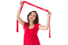 Stylish brunette in red dress holding scarf Stock Photography
