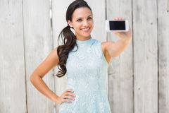 Stylish brunette taking a selfie Stock Images