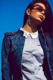 Stylish brunette in trendy sunglasses. Fashion portrait Royalty Free Stock Image