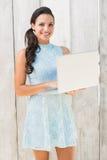 Stylish brunette using a laptop Royalty Free Stock Photography