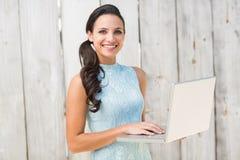 Stylish brunette using a laptop Royalty Free Stock Photo