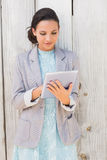 Stylish brunette using tablet pc Royalty Free Stock Image