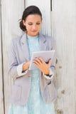 Stylish brunette using tablet pc Royalty Free Stock Image