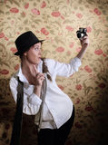 Stylish brunette woman with old camera Royalty Free Stock Photos