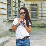 Stylish brunette woman with old  camera Stock Image
