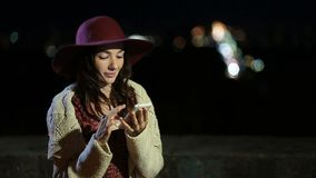 Stylish brunette woman using smartphone at night stock video footage