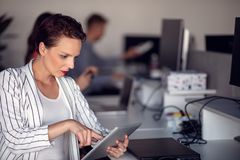 Stylish brunette working from home in her home office royalty free stock image