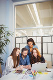 Stylish business people using laptop in meeting room Royalty Free Stock Photos