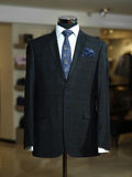 Stylish business suit on a mannequin. Black jacket with shirt and a blue  tie in a male clothing shop Royalty Free Stock Images