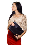 Stylish business woman brunette in red skirt with black handbag stock photo