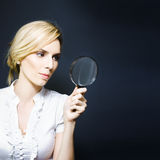 Stylish business woman with magnifying glass Royalty Free Stock Photography