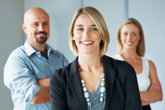 Stylish business woman with team at the back Royalty Free Stock Photography