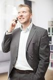 Stylish businessman chatting on his mobile phone Stock Images