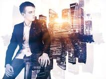 Stylish businessman on city background Stock Photo