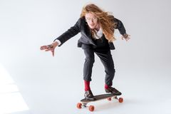 stylish businessman with curly hair skating stock photos