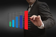 Stylish businessman point to graph Royalty Free Stock Images