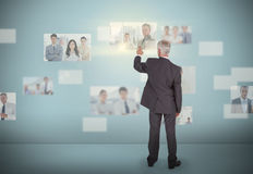 Stylish businessman selecting futuristic interface Stock Photo