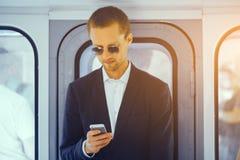 Businessman in metro train. stock image