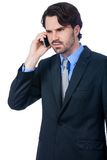 Stylish businessman talking on his mobile phone Stock Photo