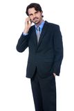 Stylish businessman talking on his mobile phone Royalty Free Stock Image