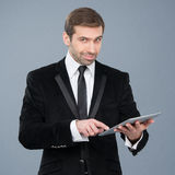 Stylish businessman using his tablet pc Stock Photo