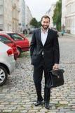 Stylish businessman walking to work Royalty Free Stock Photo