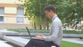 Stylish businessman   working on laptop outdoors, terrace, cup of coffee. Working on laptop outdoors. student working on laptop, Businessman working on laptop stock video footage