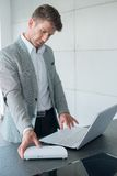 Stylish businessman working on a laptop Royalty Free Stock Image