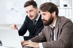 Stylish businesspeople discussing project Stock Photos