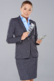 Stylish businesswoman holding dollar bills Stock Photography