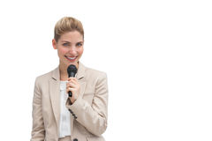 Stylish businesswoman holding microphone Stock Photo