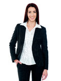 Stylish businesswoman posing with hand in pocket Stock Photos