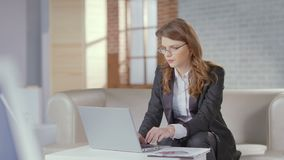 Stylish businesswoman working in luxury office, typing on laptop. Stock footage stock footage