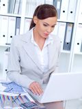 Stylish businesswoman working in an office Stock Image