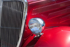 Stylish candy apple red hot rod close-up of fender, grille, hood Stock Images