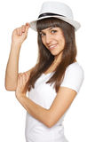 Stylish casual young woman posing with a hat Stock Photo