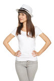 Stylish casual young woman posing with a hat Stock Photos