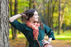 Stylish Caucasian Female Brunette Model Posing in Autumn Forest. And smiling. Horizontal Image Composition stock images