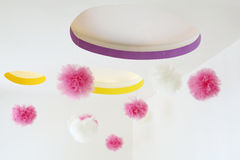 Stylish ceiling with dangling pink and white pom-poms Royalty Free Stock Photo