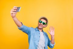 Stylish, cheerful, bearded guy in casual outfit taking a pictur royalty free stock images