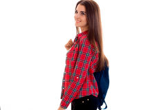 Stylish cheerful brunette student girl with blue backpack looking away and smiling isolated on white background Royalty Free Stock Images