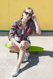 Stylish cheerful young girl with skateboard Stock Photography